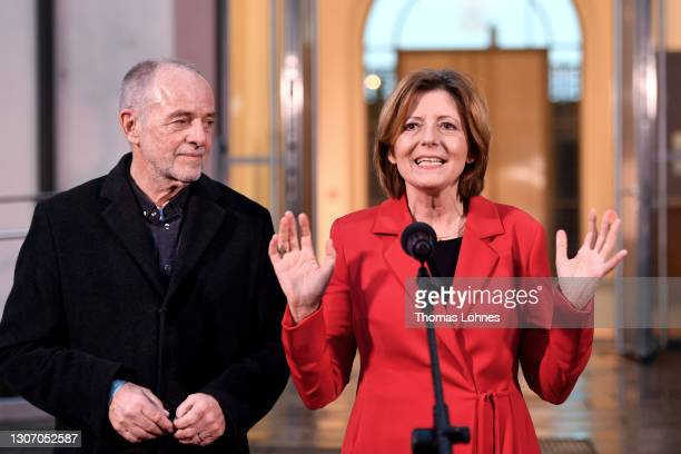 Malu Dreyer, premier of Rhineland-Palatinate and member of the German Social Democrats , and her husband Klaus Jensen speak to the media following...