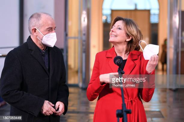 Malu Dreyer, premier of Rhineland-Palatinate and member of the German Social Democrats , takes off her face mask as she and her husband Klaus Jensen...