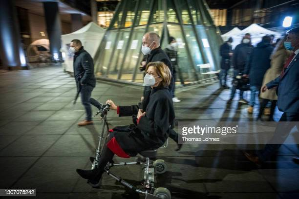 Malu Dreyer, premier of Rhineland-Palatinate and member of the German Social Democrats drives a electric scooter while and her husband Klaus Jensen...