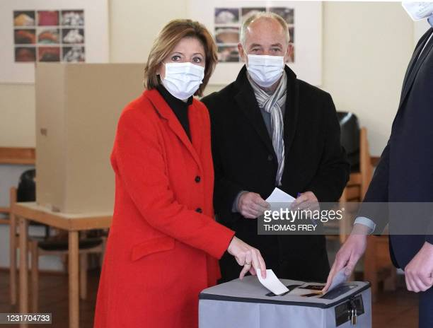 Malu Dreyer , State Premier of the western federal state of Rhineland-Palatinate, and her husband Klaus Jensen cast their ballot for state elections...