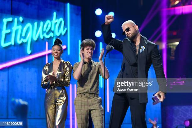 Maluma accepts an award on stage during Premios Juventud 2019 at Watsco Center on July 18, 2019 in Coral Gables, Florida.