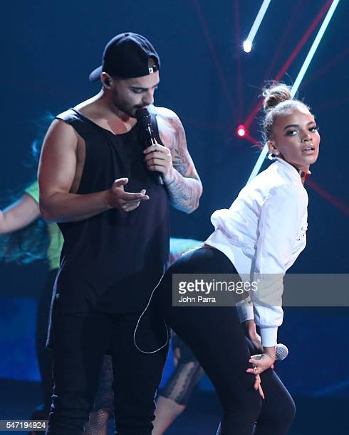 Maluma and Leslie Grace perform during Univisions Premios Juventud Awards Rehearsals Day 3 at Bank United Center on July 13 2016 in Miami Florida