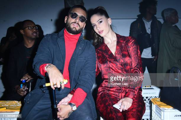 Maluma and Natalia Barulich attend John Elliott in Front Row at February 2019 - New York Fashion Week: The Shows on February 09, 2019 in New York...