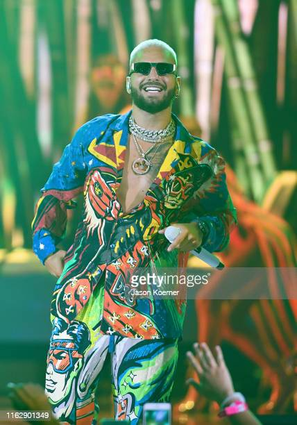Maluma performs on stage during Premios Juventud 2019 at Watsco Center on July 18, 2019 in Coral Gables, Florida.