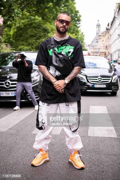 Maluma wearing a black OffWhite printed tshirt white sporty pants orange sneakers and Louis Vuitton fanny pack is seen outside OffWhite fashion show...