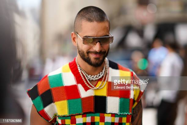 Maluma wears a multicolor checked wool sleeveless pullover, sunglasses, outside JW Anderson, during Paris Fashion Week - Menswear Spring/Summer 2020,...