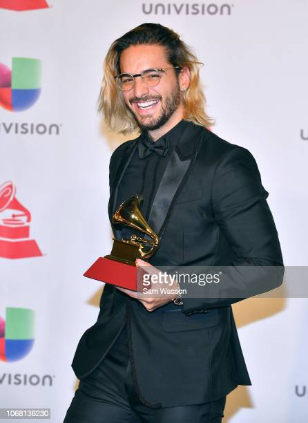 Maluma winner of Best Contemporary Pop Vocal Album for 'FAME' poses in the press room during the 19th annual Latin GRAMMY Awards at MGM Grand Garden...