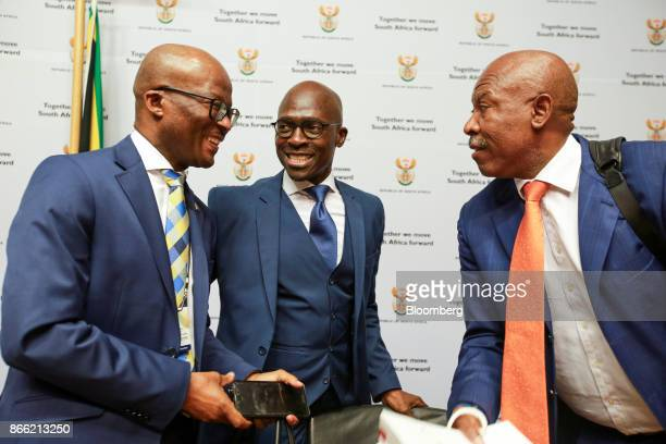 Malusi Gigaba South Africa's finance minister center speaks with Dondo Mogajane director general of the South African National Treasury left and...