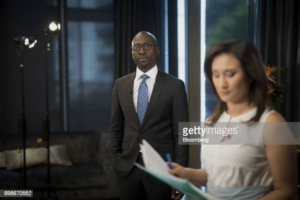 Malusi Gigaba South Africa's finance minister stands during a Bloomberg Television interview in London UK on Tuesday June 20 2017 Business confidence...