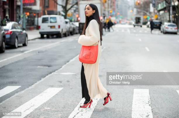 Malvika Sheth is seen wearing two tone black creme white dress Weili Zheng from Yoox, Fendi shoes, red Hermes bag during New York Fashion Week Fall /...