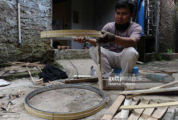 Malvino Purba Alam Head of Research Department in Indonesian Bamboo Community works to make a bamboo tympani at his workshop on April 17 2014 in...