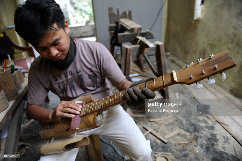 Malvino Purba Alam, 32, Head of Research Department Indonesian Bamboo Community works to make a bamboo guitar at his workshop on April 17, 2014 in Bandung, Java, Indonesia. Adang Muhidin, founder of Indonesian Bamboo Community, and his friends make sustainable bamboo musical instruments (guitar, violin, bass, trumpet, clarinet, saxophone, drums) a nod to the rise of the creative economy in Indonesia.