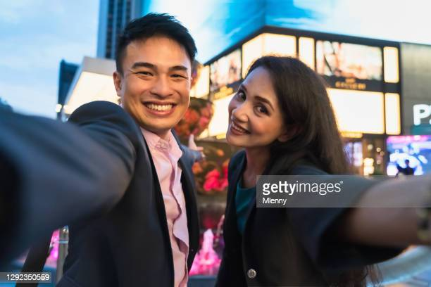 malyasian couple taking selfies in kuala lumpur at night malaysia - downtown comedy duo stock pictures, royalty-free photos & images