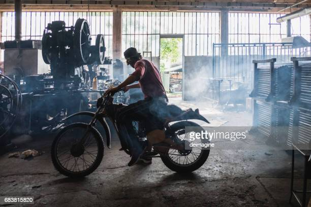 mam mechanic testing motorbike - vintage motorcycle stock pictures, royalty-free photos & images