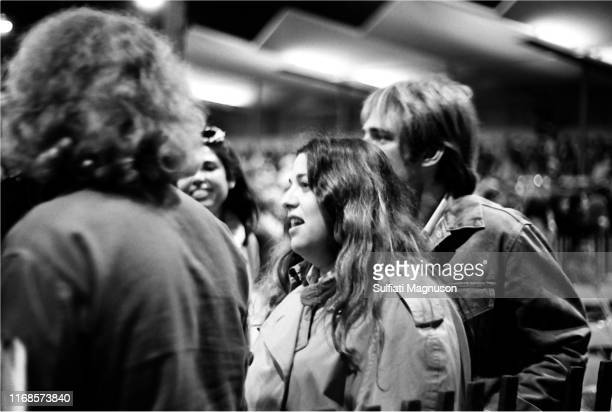 Mama Cass Elliot and friend Lee mingling with friends at The Monterey International Pop Festival in the intimate setting of the Monterey Fair Grounds...
