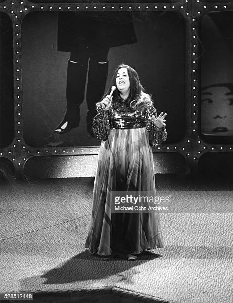 Mama Cass Elliot of the rock and roll band The Mamas And The Papas performs onstage during the Mama Cass Television Program which aired on June 26...