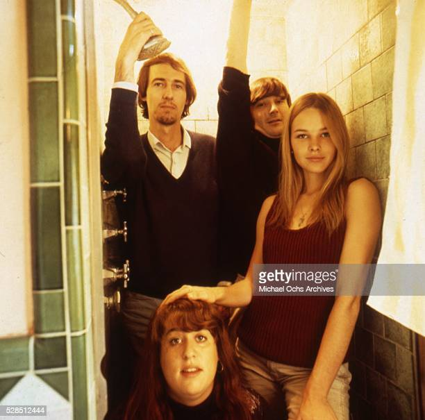 Mama Cass John Phillips Denny Doherty and Michelle Phillips of the rock and roll band The Mamas And The Papas pose for a portrait session in a shower...
