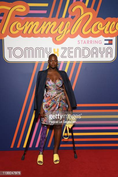 Mama Cax attends the Tommy Hilfiger TOMMYNOW Spring 2019 TommyXZendaya Premieres at Theatre des ChampsElysees on March 02 2019 in Paris France