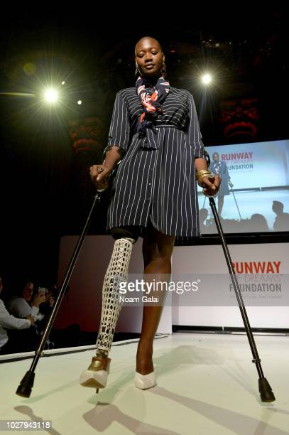 Mama Cax walks in Tommy Hilfiger during the Runway Of Dreams Foundation Fashion Revolution Event at Cipriani 42nd Street on September 5 2018 in New...