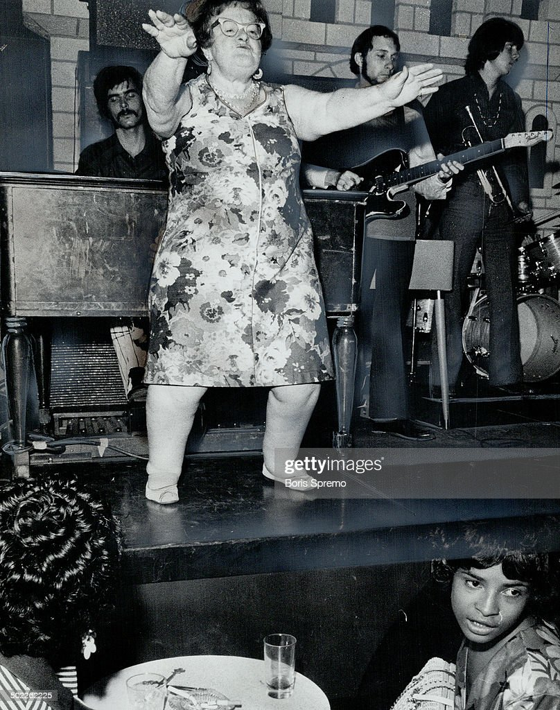 Mama Chikie does her thing at the Coq d'Or as probably the oldest go-go dancer. She has become a Wed : News Photo