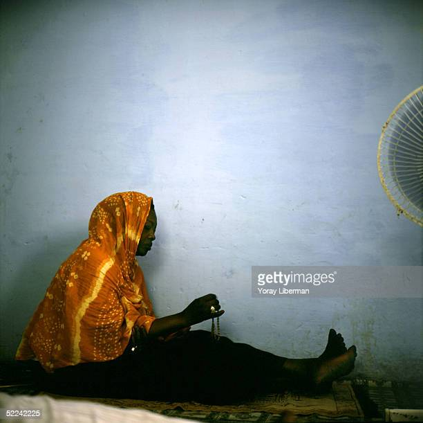 Mama Lo prays at home during the Magal De Touba April 21 2003 in Mbake Senegal The Mouride Baye Fall community in Senegal celebrates the Magal De...