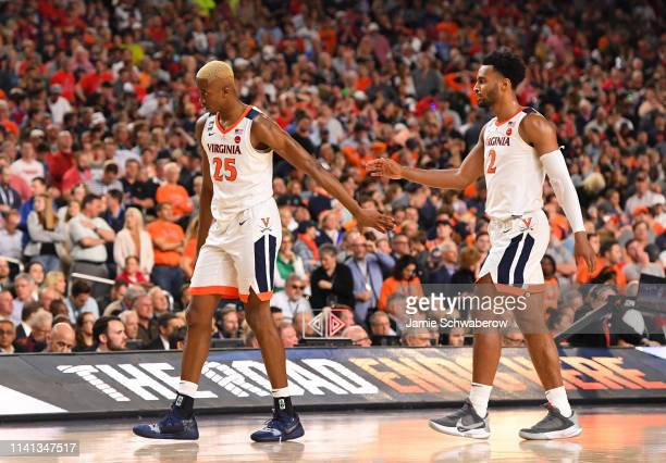 Mamadi Diakite and Braxton Key of the Virginia Cavaliers celebrate during overtime against the Texas Tech Red Raiders in the 2019 NCAA men's Final...