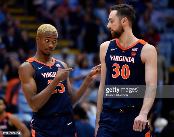 Mamadi Diakite jokes with teammate Jay Huff of the Virginia Cavaliers during the second half of their game against the North Carolina Tar Heels at...