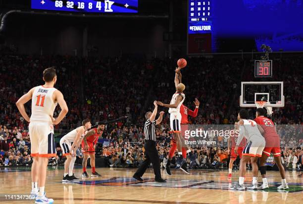 Mamadi Diakite of the Virginia Cavaliers and Norense Odiase of the Texas Tech Red Raiders compete for a jump ball during overtime of the 2019 NCAA...
