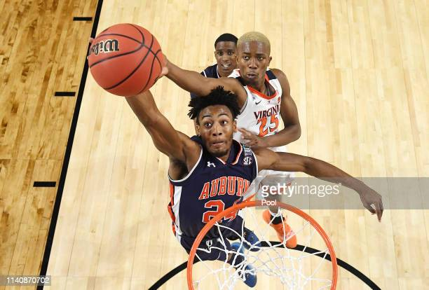 Mamadi Diakite of the Virginia Cavaliers attempts to block a shot by Anfernee McLemore of the Auburn Tigers in the first half during the 2019 NCAA...