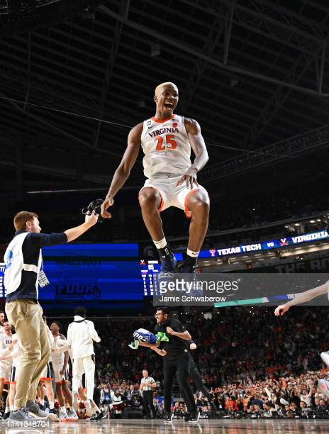Mamadi Diakite of the Virginia Cavaliers celebrates after defeating the Texas Tech Red Raiders in the 2019 NCAA Photos via Getty Images men's Final...