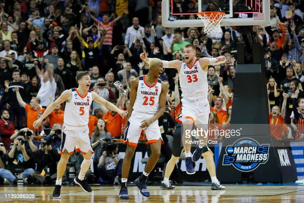 Mamadi Diakite of the Virginia Cavaliers celebrates after making a game-tying shot over Matt Haarms of the Purdue Boilermakers to extend the game to...