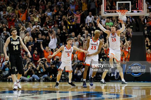 Mamadi Diakite of the Virginia Cavaliers celebrates after making a gametying shot over Matt Haarms of the Purdue Boilermakers to extend the game to...