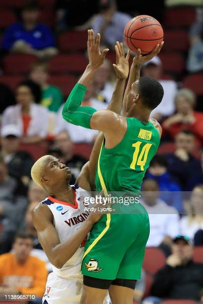Mamadi Diakite of the Virginia Cavaliers defends a shot by Kenny Wooten of the Oregon Ducks during the first half of the 2019 NCAA Men's Basketball...