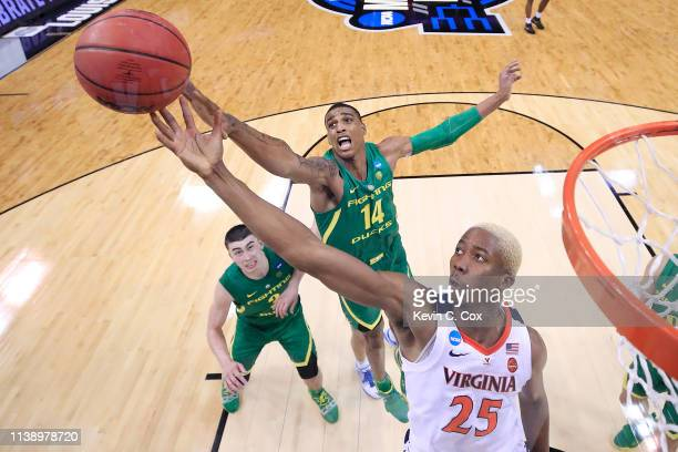 Mamadi Diakite of the Virginia Cavaliers goes up for a rebound against Kenny Wooten of the Oregon Ducks during the second half of the 2019 NCAA Men's...