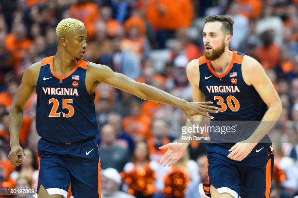 Mamadi Diakite of the Virginia Cavaliers greets teammate Jay Huff following a made basket against the Syracuse Orange during the second half at the...