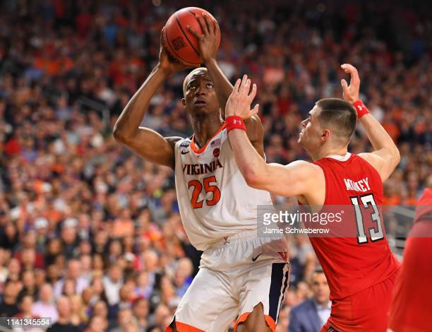 Mamadi Diakite of the Virginia Cavaliers is defended by Matt Mooney of the Texas Tech Red Raiders during the second half of the 2019 NCAA men's Final...