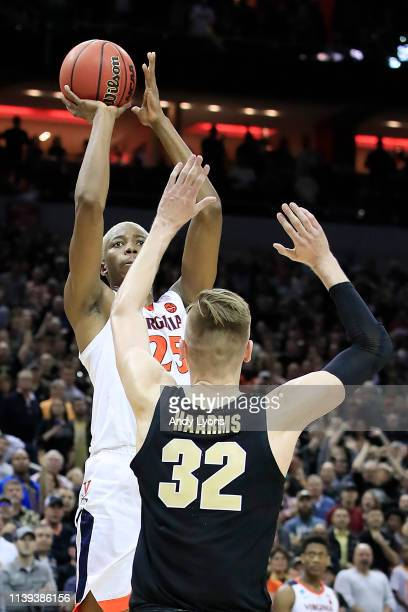 Mamadi Diakite of the Virginia Cavaliers makes a gametying shot over Matt Haarms of the Purdue Boilermakers to extend the game to overtime as time...