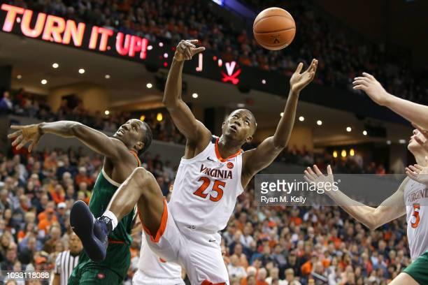 Mamadi Diakite of the Virginia Cavaliers rebounds beside Ebuka Izundu of the Miami Hurricanes in the first half during a game at John Paul Jones...