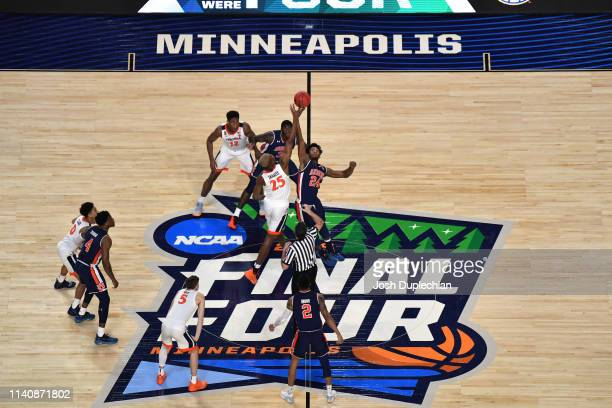 Mamadi Diakite of the Virginia Cavaliers tips off against Anfernee McLemore of the Auburn Tigers during the first half of the semifinal game in the...