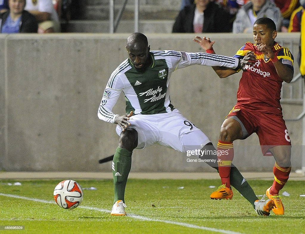 Mamadou Danso #98 of the Portland Timbers pushes Joao Plata #8 of Real Salt Lake out of bounds during the second half of their game at Rio Tinto Stadium April 19, 2014 in Sandy, Utah. Real Salt Lake won 1-0.