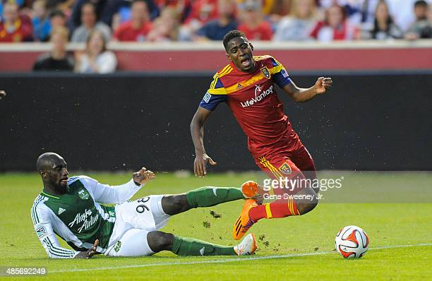 Mamadou Danso of the Portland Timbers trips Olmes Garcia of Real Salt Lake during the first half of their game at Rio Tinto Stadium April 19 2014 in...