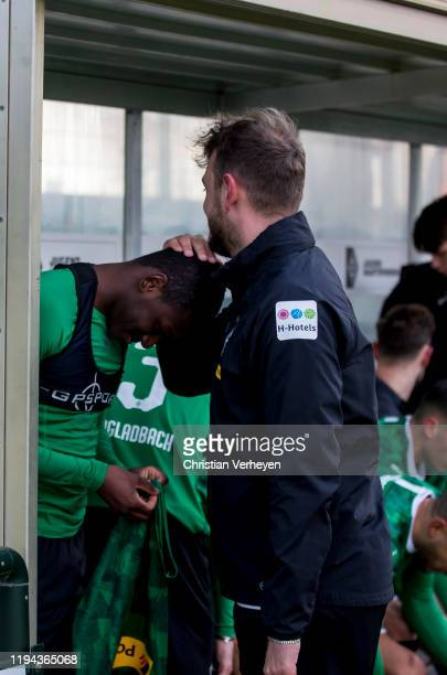 Mamadou Doucoure and Assistant Coach Rene Maric of Borussia Moenchengladbach are seen ahead the friendly match between Borussia Moenchengladbach and...