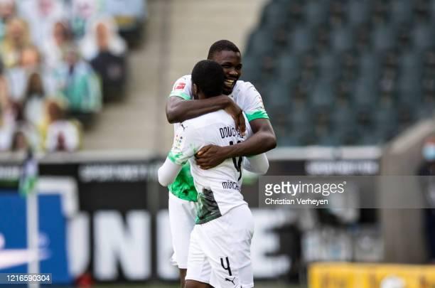 Mamadou Doucoure and Marcus Thuram of Borussia Moenchengladbach are seen during the Bundesliga match between Borussia Moenchengladbach and 1 FC Union...