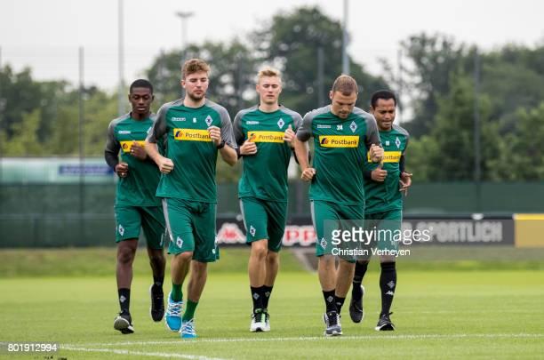 Mamadou Doucoure Christoph Kramer Marvin Schulz Tony Jantschke and Raffael run during a training session of Borussia Moenchengladbach at BorussiaPark...