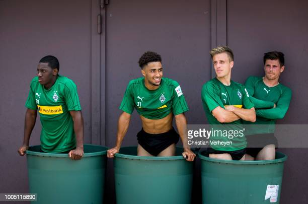 Mamadou Doucoure Keanan Bennetts Patrick Herrmann and Jonas Hofmann cool down during a Training Session at Borussia Moenchengladbach Training Camp at...