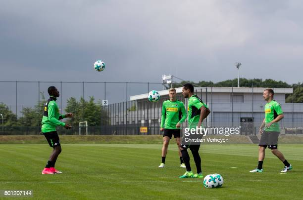 Mamadou Doucoure Marvin Schulz Raffael and Tony Jantschke during a training session of Borussia Moenchengladbach at BorussiaPark on June 26 2017 in...