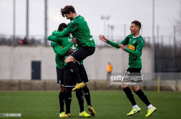 Mamadou Doucoure of Borussia Moenchengladbach celebrate with his team mates after he score his teams first goal during the friendly match between...