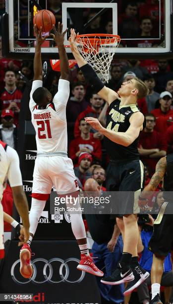 Mamadou Doucoure of the Rutgers Scarlet Knights attempts a shot as Isaac Haas of the Purdue Boilermakers defends during a game at Rutgers Athletic...