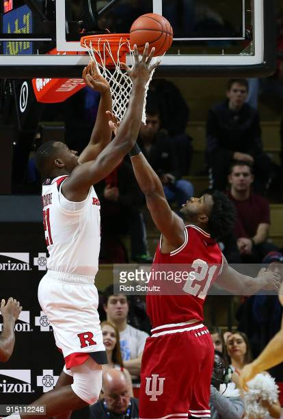 Mamadou Doucoure of the Rutgers Scarlet Knights attempts a shot as Freddie McSwain Jr #21 of the Indiana Hoosiers defends during the first half of a...
