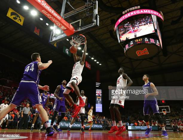 Mamadou Doucoure of the Rutgers Scarlet Knights dunks as Gavin Skelly of the Northwestern Wildcats watches during the second half of a game at...